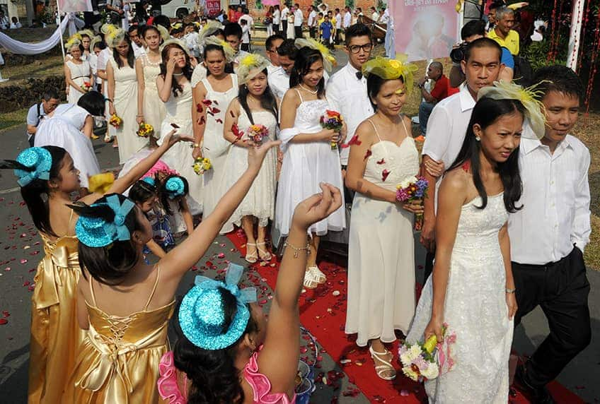 hundreds of couples come together for a mass wedding on Valentine's Day