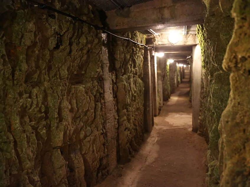 the underground tunnel at Vimy Ridge lit up with electric lighting