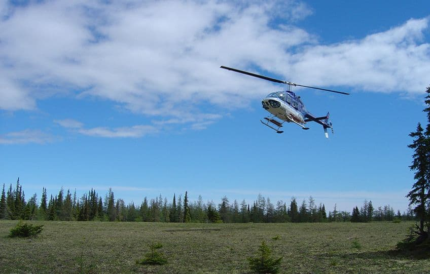 helicopter landing in the tundra