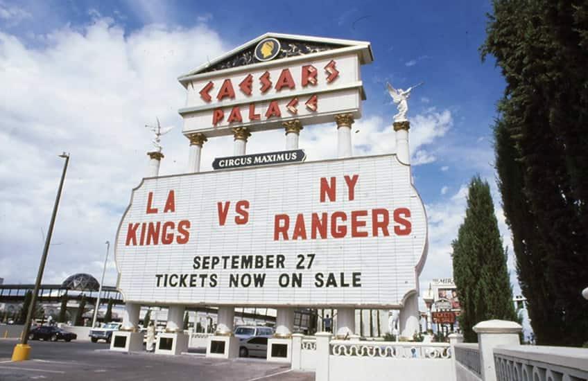 The Caesars Palace sign in Las Vegas advertising the Kings versus Rangers hockey game