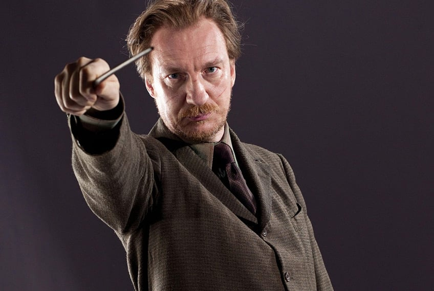 still from Harry Potter movie showing Remus Lupin holding a wand