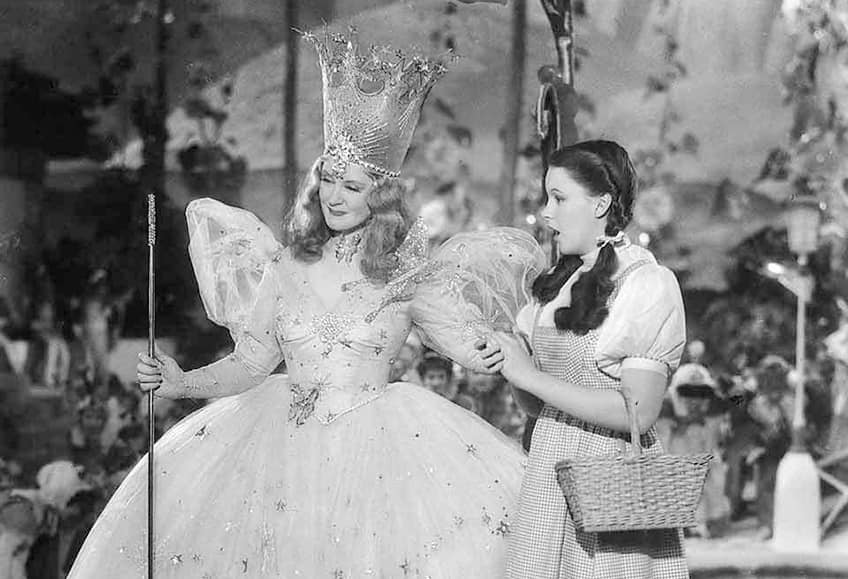 still from Wizard of Oz movie with Glinda and Dorothy