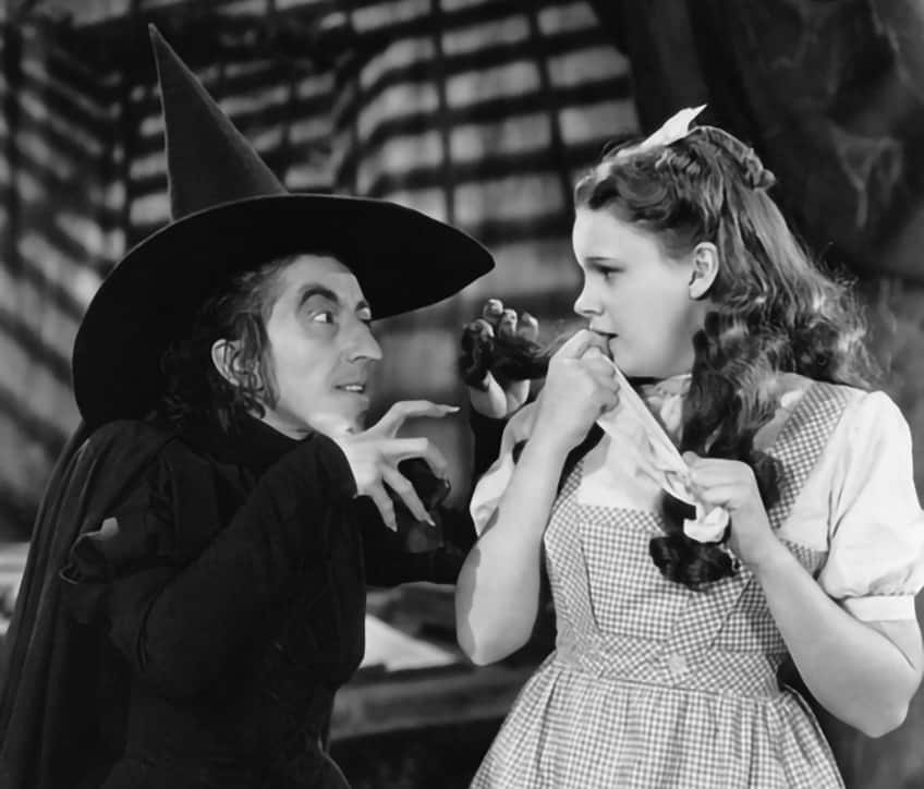 wizard of oz movie still with wicked witch and Dorothy