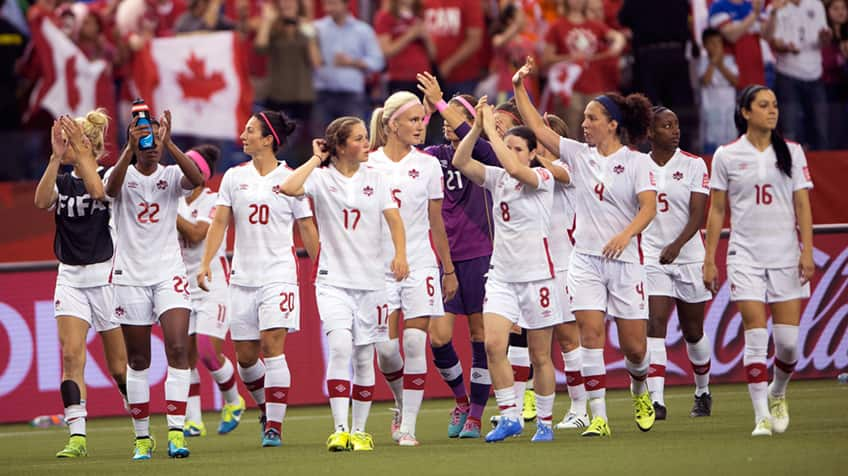Canada's players salute the crowd after their draw in Netherlands during the second half Women's World Cup Soccer in Montreal 2015