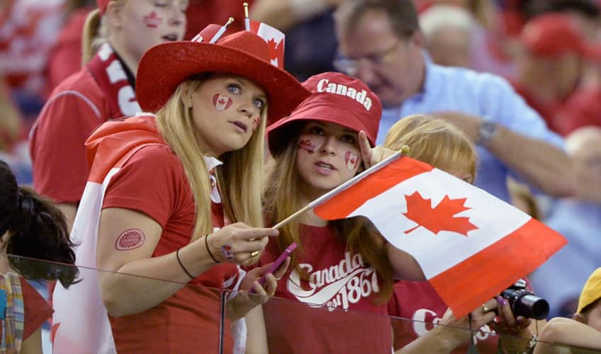 Canadian fans wait for the start of the Netherlands-Canada FIFA Women's World Cupgame in Montreal on Monday, June 15, 2015