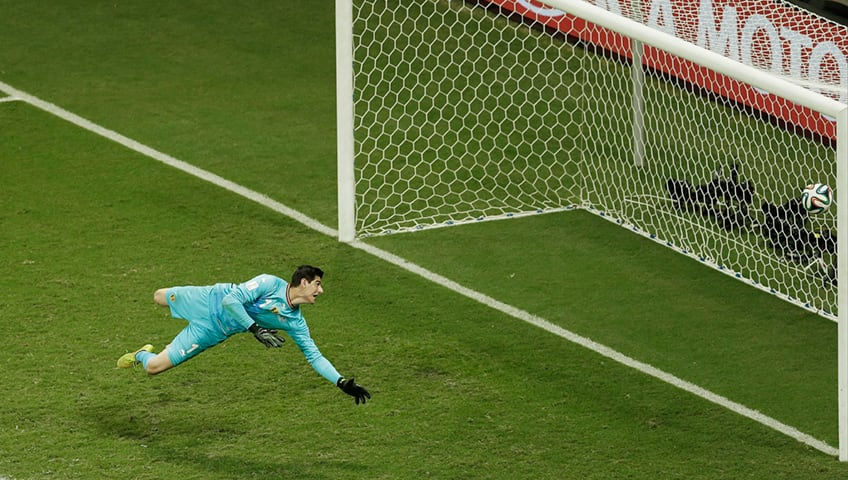 Belgium's goalkeeper Thibaut Courtois looks to theball crossing the line as United States' Julian Green scored his side's first goal during the World Cup round of 16