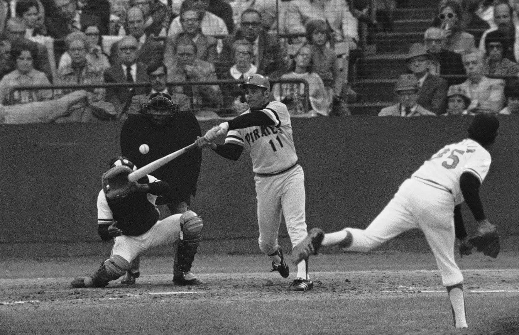 This Oct. 17, 1971, file photo shows Pittsburgh Pirates' Jose Pagan (11) hitting a double, off Baltimore Orioles pitcher Mike Cuellar, to drive in the eventual winning run in Game 7 of the World Series, in Baltimore.