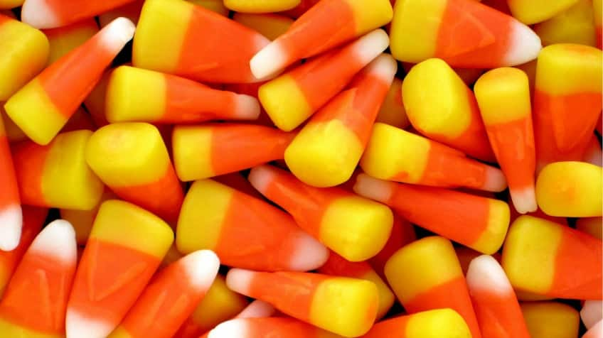 A pile of yellow, orange and white candy corn