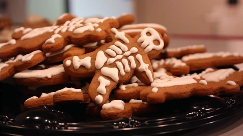 A stack of skeleton-decorated gingerbread cookies