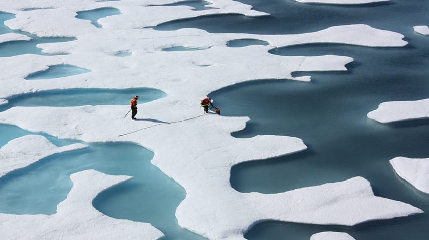 Two people on the ice of the Arctic