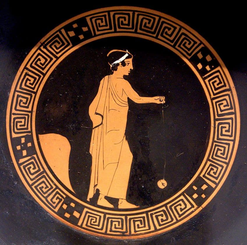 ancient greek vase with image of person playing yo-yo