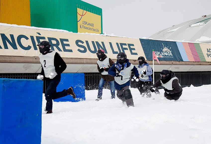 People participating in yukigassen - a Japanese version of a snowball fight.