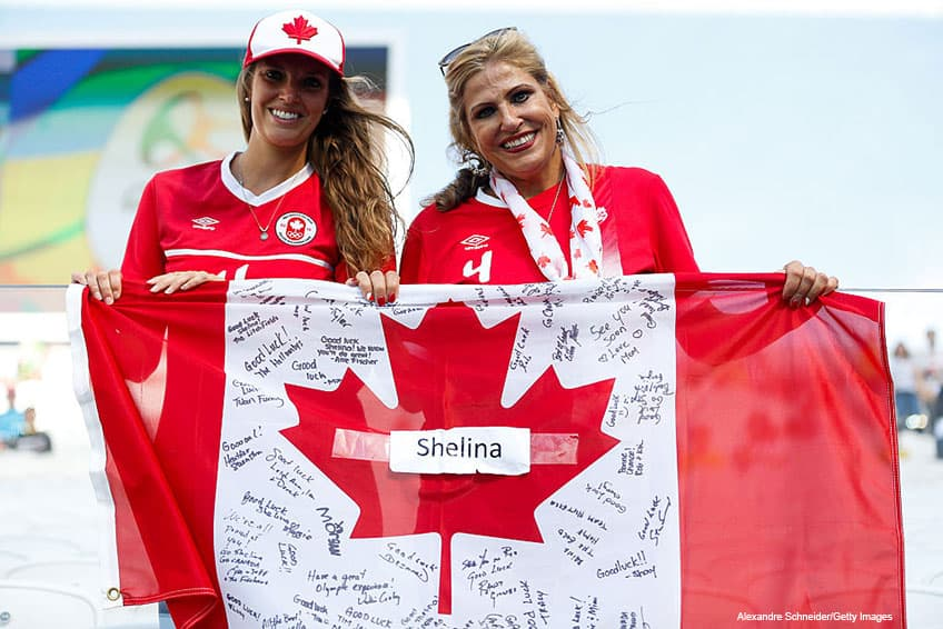 fans of Canada hold up a signed flag before the match between Zimbabwe and Canada womens football