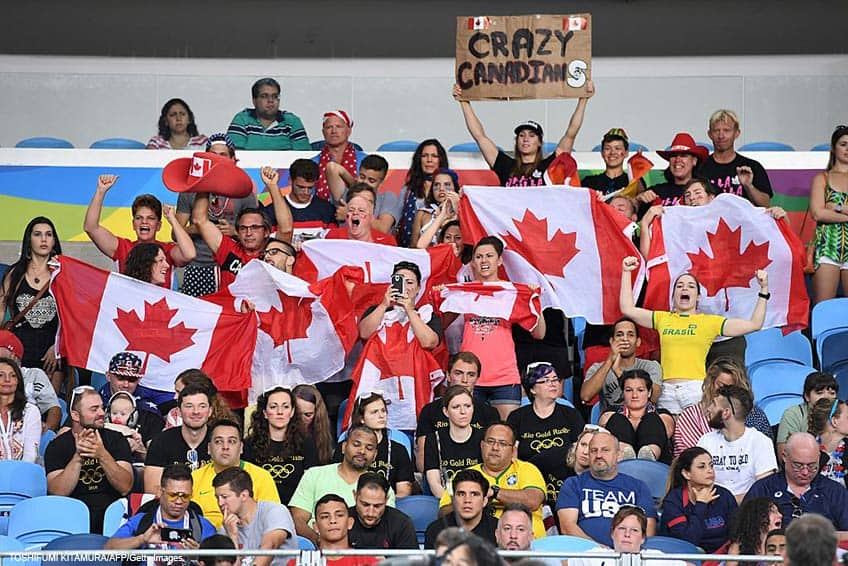 A fan holds up a Crazy Canadians sign in the stands