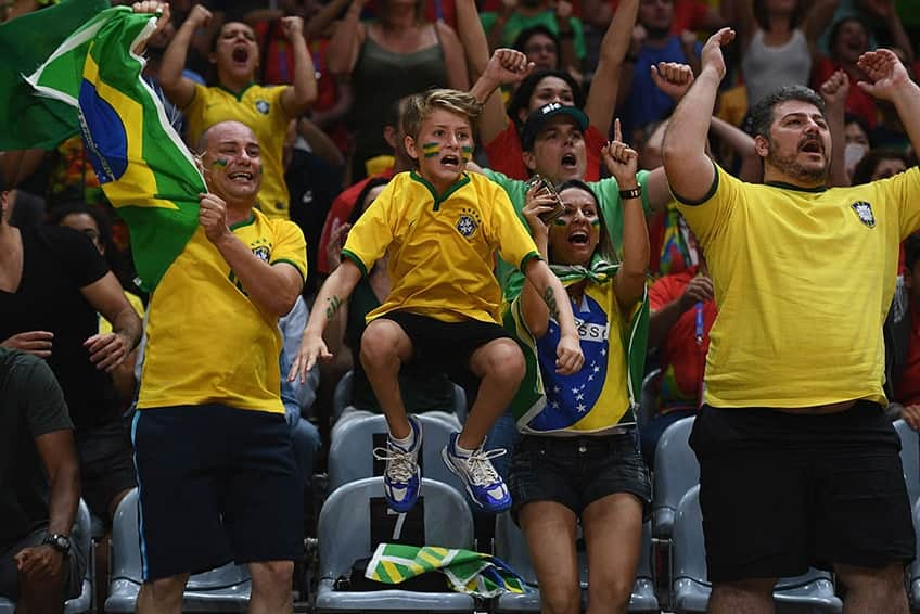 A young fan of Brazil is so happy he looks like he's levitating on Day 11