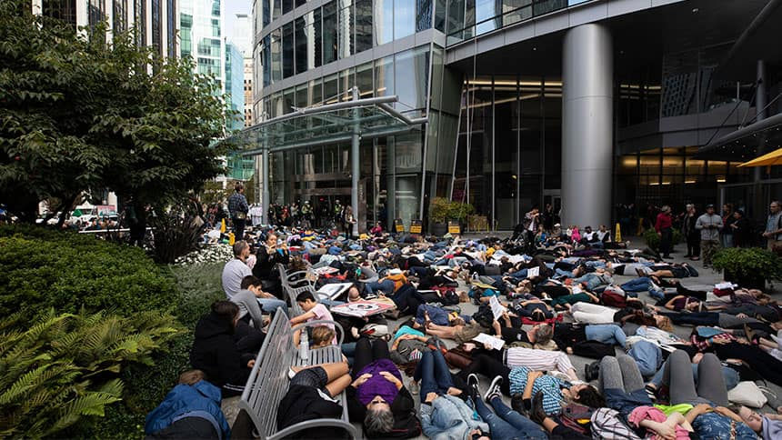 Climate activists lie on the ground as part of a climate 'die-in' (a non-violent protest) outside the Teck Resources building in downtown Vancouver in September 2019.