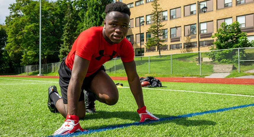 Abdul Berete in his workout gear, training on his school's soccer field.