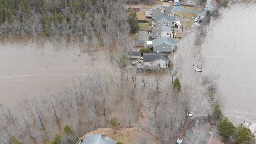 Aeriel view shows houses surrounded by water.