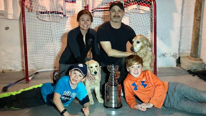 Whole family poses with the fake Stanley Cup.