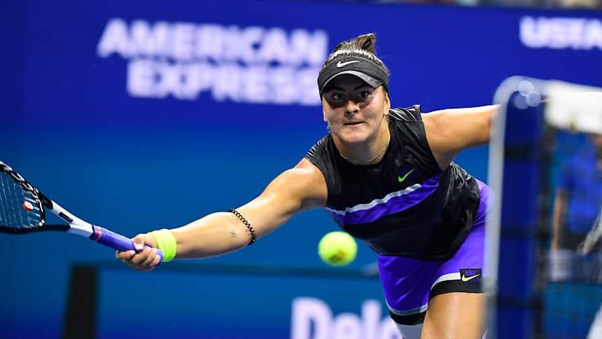A tennis player plays a tennis match.