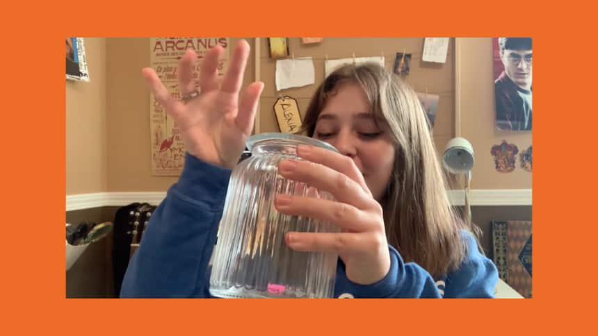 Alexia Sabau placing an idea for a post-pandemic activity into her own positivity jar.