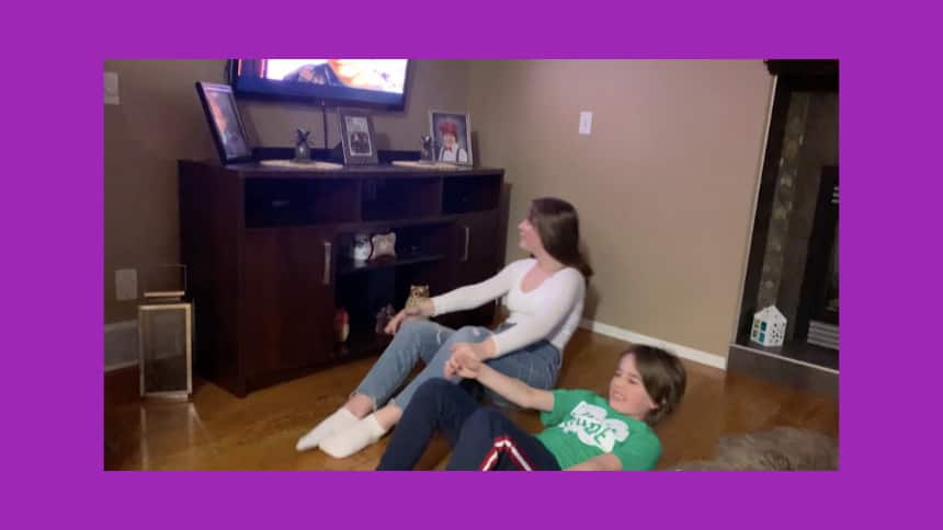 Alexia Sabau and her brother, Max, doing a movie workout at home.