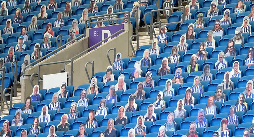 Cut out pictures of fans in seats at a stadium