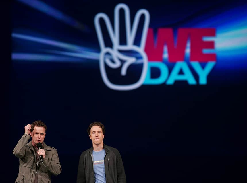 WE Charity co-founders Craig and Marc Kielburger onstage at WE Day.