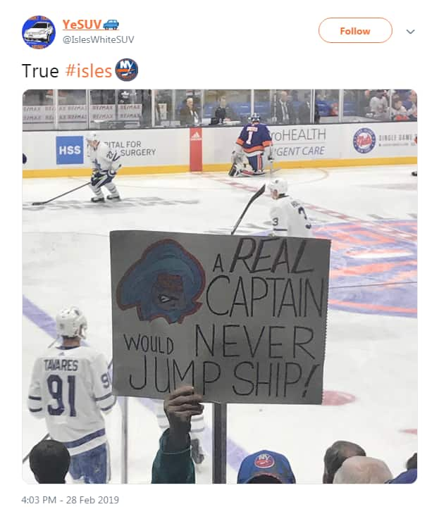 Tweet from YeSUV shows fan holding sign that says A real captain would never jump ship!