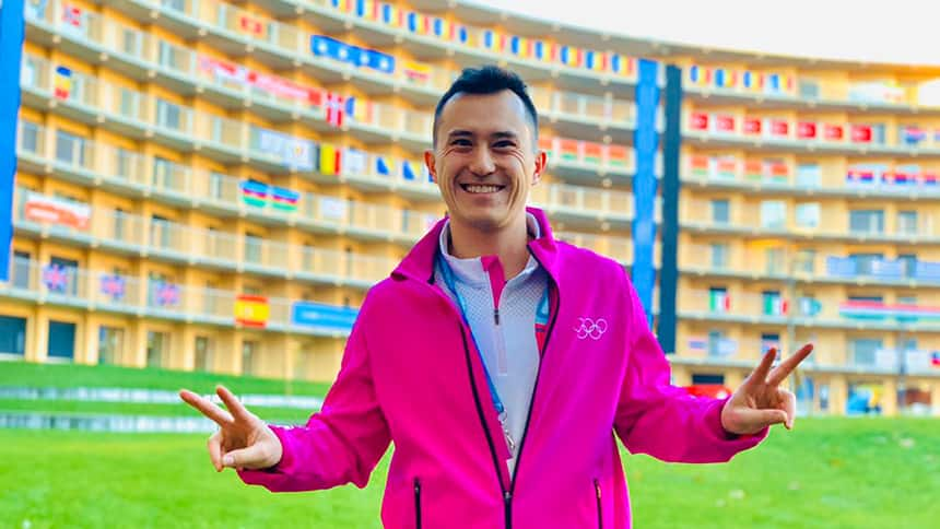 Patrick Chan poses in front of the athlete's village for the Youth Olympic Games.