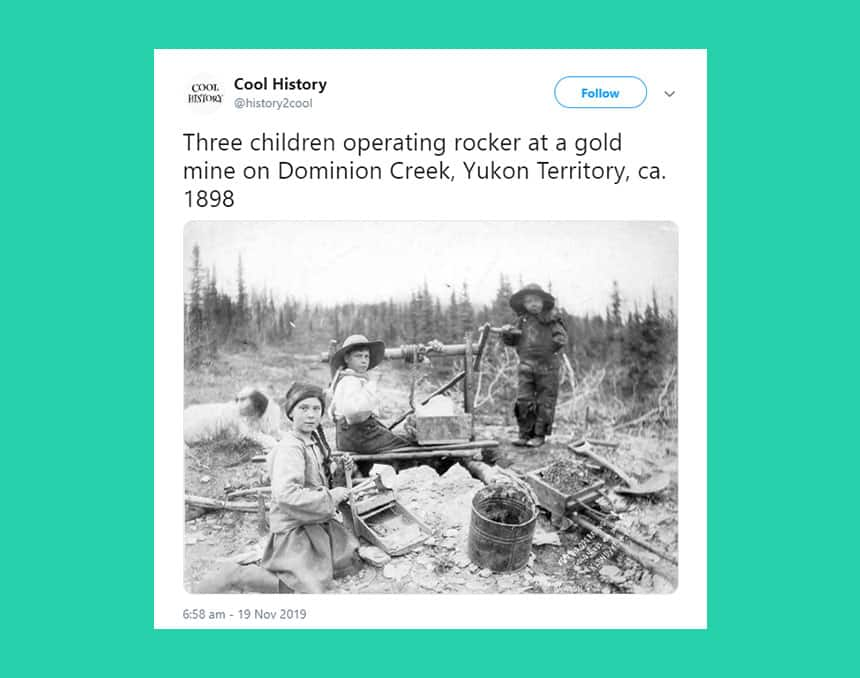 Tweet from Cool History shows black and white photo of kids in nature surrounded by tools with caption: Three children operating rocker at a gold mine on Dominion Creek, Yukon Territory, ca. 1898