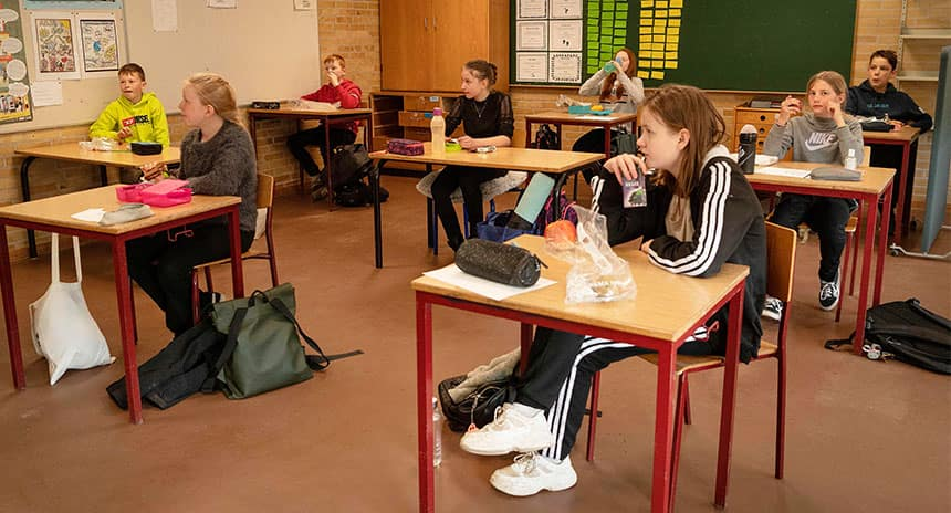 Students in a classroom spread apart