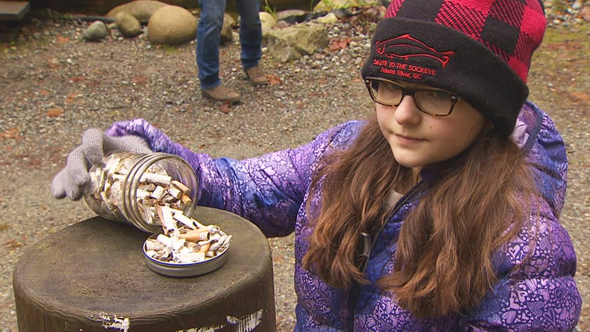 Young girl collects thousands of cigarette butts in large mason jar
