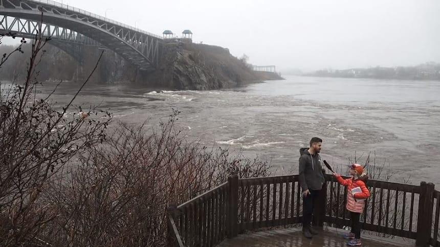 Graeme Stewart-Robertson speaks with Kaiya Hemmings next to the Reversing Falls Rapids.