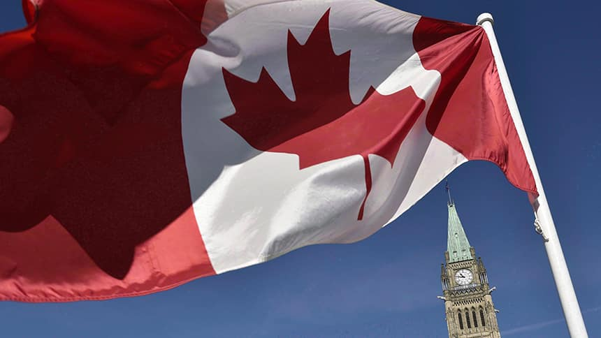 Canadian flag flies above the federal government meetings in Ottawa.