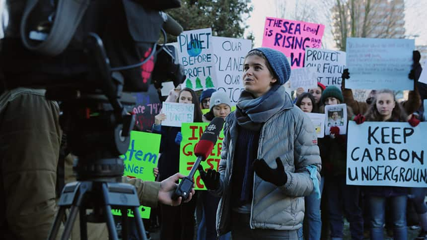 A protester speaks to a news camera