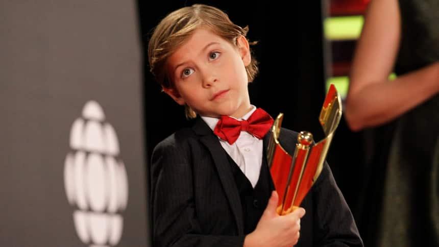 Jacob Tremblay holding a CSA trophy.