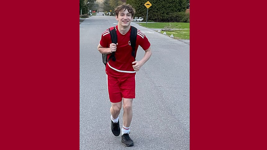 Teenager running in the street.