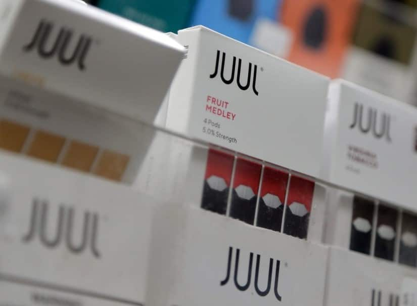 Juul packages showing flavour names.