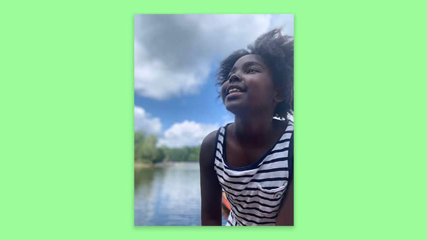 Kennedy smiling in front of a lake. She said she hopes to create more music in the future.