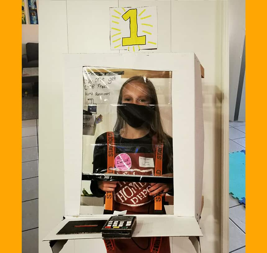 Girl wears cash register that hangs from her shoulders over her belly with mask and gloves