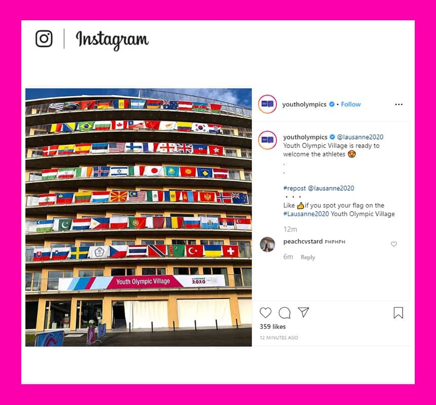 Instagram post via @youtholympics. Pictured is a building facade lined with balconies on each of its 8 floors. Each balcony is covered with the flags of different nations. The first floor balcony has a banner that reads Youth Olympic Village Lausanne 2020. The post text reads:Youth Olympic Village is ready to welcome the athletes, heart eyes emoji