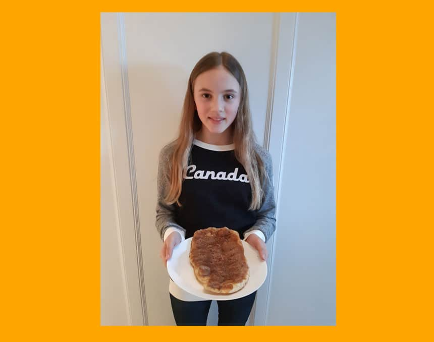 Cassandra Currie holds a BeaverTail pastry on a plate.