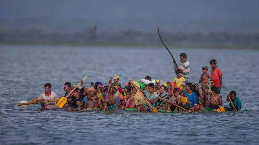 Dozens of people on an overcrowded boat using sticks and paddles to move.