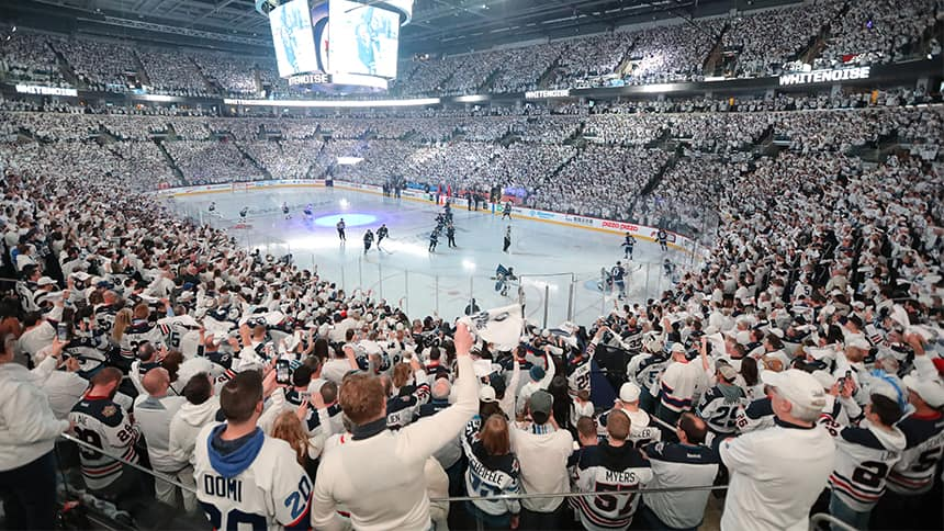 Winnipeg Jets fans cheer in the stands.