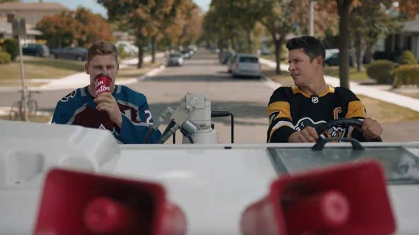 Nathan MacKinnon and Sidney Crosby sit on a zamboni drinking Tim Hortons coffee.