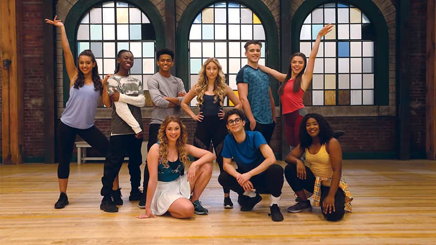 Group shot of all the Next Step dancers posing in a dance studio.