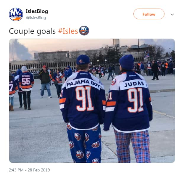 Tweet from IslesBlog shows two people in pyjama pants with jerseys that have the number 91 and the Tavares name covered by Pajama Boy and Judas. Tweet says Couple goals #Isles.