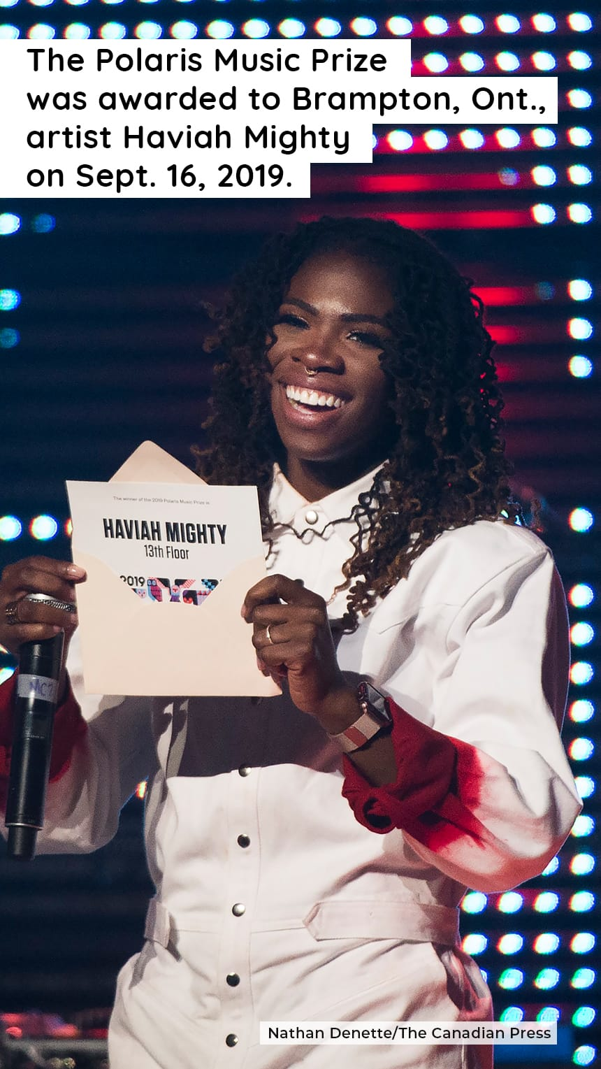 TEXT:  The Polaris Music Prize was awarded to Brampton, Ont., artist Haviah Mighty on Sept. 16, 2019. IMAGE: A smiling woman holds an open envelope.