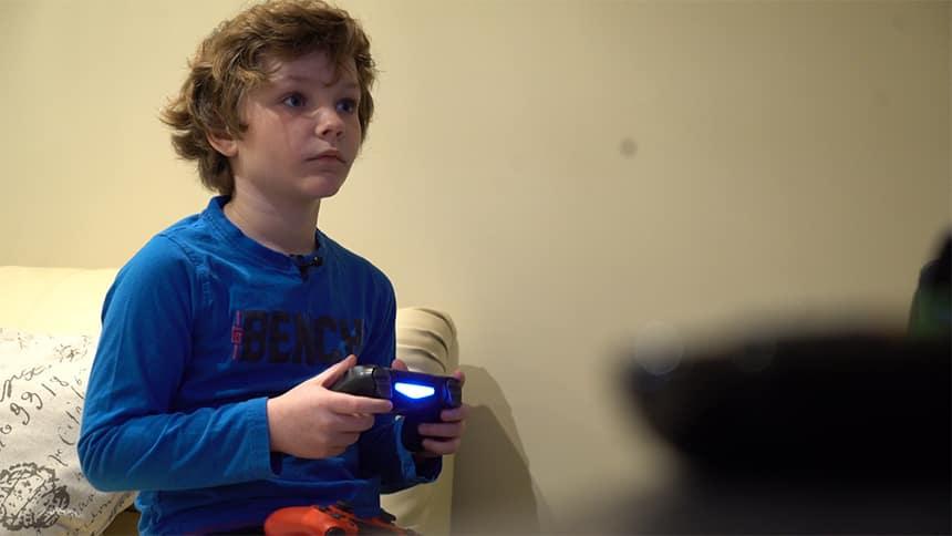 Callum Predergast plays on a gaming console.